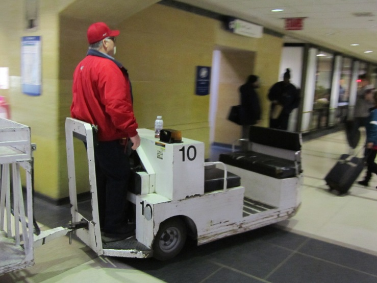 This dude is owning it. I would love to drive one of those baggage carts.